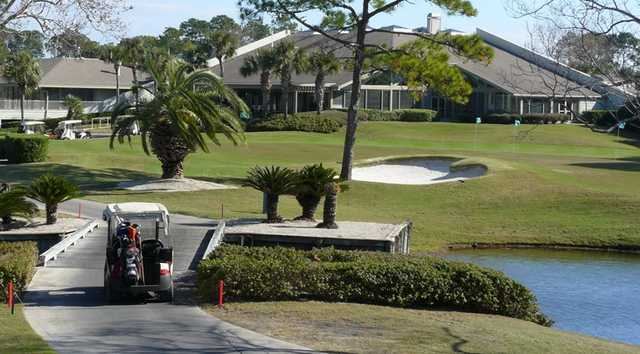 A View Of The Clubhouse With Putting Green On Right At Sawgr Country Club