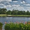 A view over the water of green #5 at Interlachen Country Club.