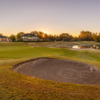 A sunset view of a hole at Wentworth Golf Club.