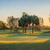 A sunset view of a green at Palm Beach National Golf Course.