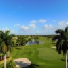 A sunny day view of a green at Spanish Wells Country Club.