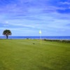 A sunny day view of a green at The Ocean Course from Hammock Beach Resort.