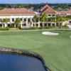 A view of the clubhouse and a green from The Club at Ibis.