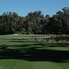 A view from tee of the 4th hole surrounded by water at Sugar Mill Country Club - Blue Course