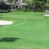 A view of the 18th green guarded by bunkers at Pines from Royal Poinciana Golf Club