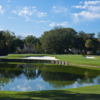 A view over the water of a green guarded by bunkers at Palma Ceia Golf & Country Club
