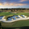 A view of a hole protected by an undulating bunker at Venetian Golf & River Club