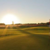 A sunny view of a green at Origins Golf Club