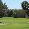 A view of a green guarded by a collection of bunkers at Hacienda Hills Golf & Country Club