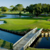 A view of a green surrounded by water at Palm-Aire Country Club