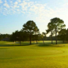 A sunny day view of a hole at Holiday Golf Club