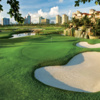 A view of a green protected by bunkers at Turnberry Isle Resort & Club