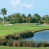 A view of a green flanked by sand traps at Gulf Stream Golf Course