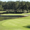 A view of green #12 surrounded by water at Golden Eagle Country Club