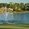 View of a green and lake at DeBary Golf and Country Club