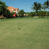 A view of a green and clubhouse at Keys Gate Golf Club