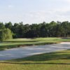 A view of the 11th green with bunkers on sides at Spruce Creek Country Club