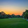A sunset view of a hole at Forest Country Club.