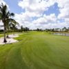 A sunny day view of a hole at Hibiscus Golf Club.