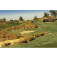 Steep, wooden-walled, whiskey barrel bunkers make up nine of the 36 bunkers at Mystic Dunes Golf Club near Orlando.