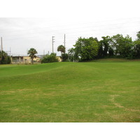 The first green at Jacksonville Beach Golf Club is a riot of swales, mounds and ridges, both next to and on the green.