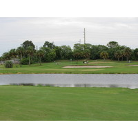 A large water carry separates the fairway and the eighth green at Jacksonville Beach Golf Club. Several holes converge behind the green, creating a visual disturbance.
