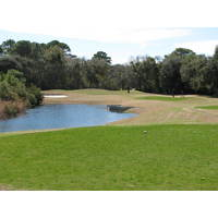 The par-3 fourth hole at Amelia River Golf Club punishes short shots.