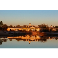 The clubhouse at Eagle Landing at Oakleaf Plantation glows in the sunset.