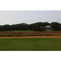 A marsh divides the 14th fairway from the green at the Golf Club of Amelia Island.