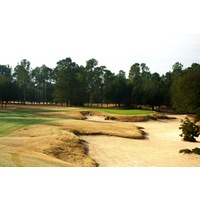 The eighth hole on World Woods Golf Club's Pine Barrens Course features a green well protected by bunkers down the right side.