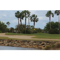 Water lined by rocks is a signature feature at Stoneybrook Golf Course in Estero, Florida.