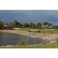 Rocks and a water hazard pinch the approach to the third green at Arrowhead Golf Club in Naples, Florida.