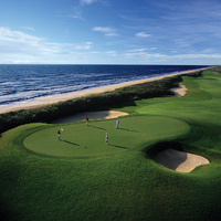 Be careful on the par-4 ninth on Hammock Beach Resort's Ocean Course. There are deep bunkers and grass hollows just waiting for errant shots.