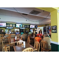 The Sports Grill at the Country Club of Miami has become a popular gathering spot on weekends.