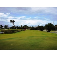 Palm Beach Par 3 Golf Course's fourth hole plays 196 yards, with water right of the green.