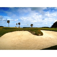 Large bunkers protect many of the greens at Palm Beach Par 3 Golf Course.