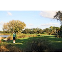 The sixth hole on the Osprey nine at Raptor Bay Golf Club is a short but tough par 3.