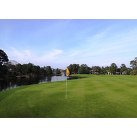 Water down the right side adds to the difficulty of the par-3 sixth at Burnt Pine Golf Club in Destin, Florida.