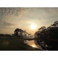 Don't miss the sunset view of the 13th hole and Choctawhatchee Bay at Burnt Pine Golf Club in Destin, Florida.