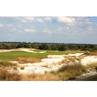 The 17th on the Red golf course at Streamsong is a 403-yard dogleg right around sand.
