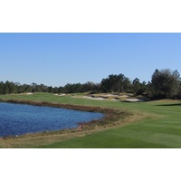 The third hole at Camp Creek Golf Club is a 542-yard par 5 that plays alongside a lake.